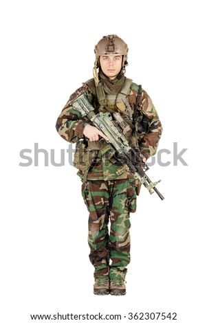 standing in woodland camouflage and modern machine gun. Isolated on white - stock photo