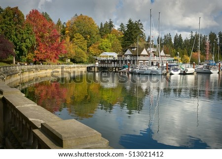 Stanley Park Autumn, Vancouver. Stanley Park fall colours reflect in Coal Harbour by the Vancouver Rowing Club. A perfect day.