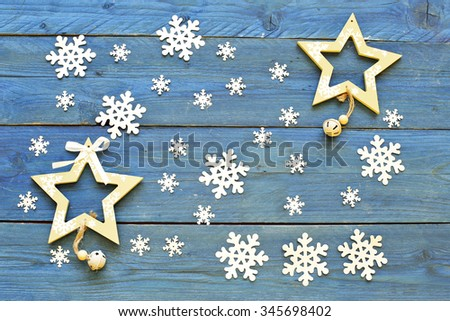 Stars and snowflakes on blue wooden background - stock photo