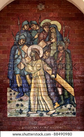 Stations of the Cross: Jesus carrying the cross on his back; A panel of Portuguese tiles outside the shrine of Fatima - stock photo