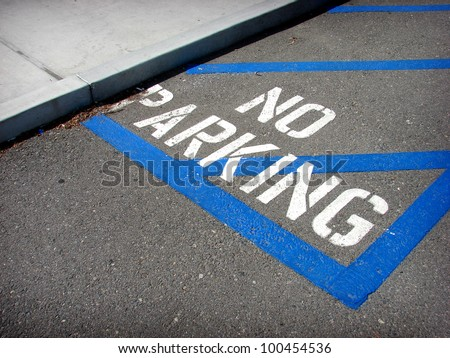 stenciled on ground no parking sign - stock photo