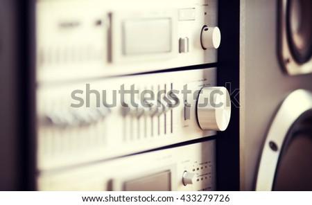 Stereo Audio Music Rack Component Control Knob Closeup Blurred  - stock photo