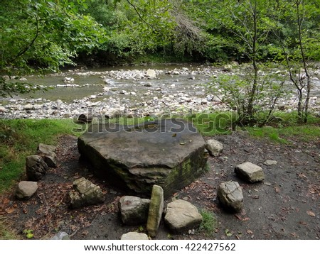 stone in the form of heart on the banks of a mountain river, Russia