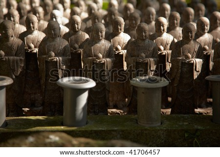 1001 stone monks statues from Hasedera in Kamakura, Japan. Shallow focus image - stock photo