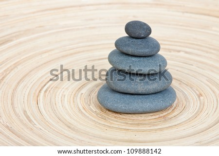 Stone tower on a wooden board