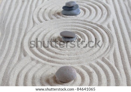 stones on a sand background - stock photo