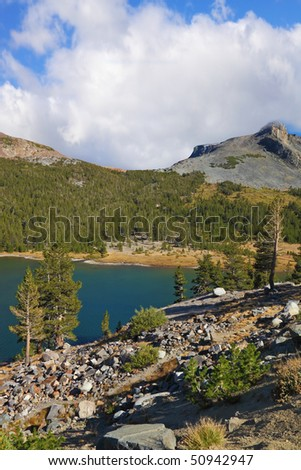 Stony coast of mountain lake Elleri in park Yosemite, the USA