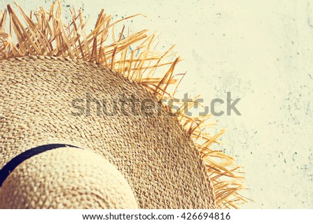 straw hat on a gray background. view from above. space for text - stock photo