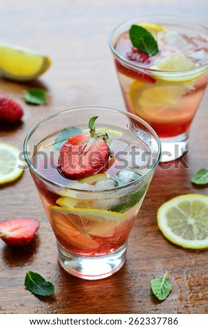 Strawberry and lemon cold drink with mint, selective focus, vertical - stock photo