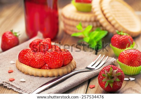 Strawberry biscuit  on a wooden background - stock photo