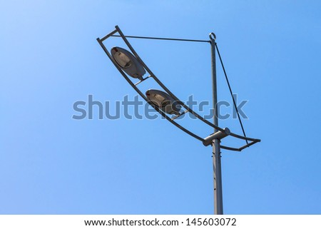 Street light on a blue sky background.