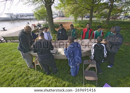 """""""Students view Indian canoe during """"""""Earth Force"""""""" Earth Day event in Alexandria, Virginia on Potomac River"""" - stock photo"""