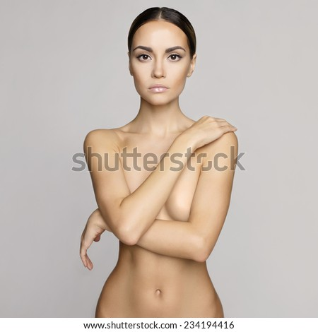 studio photo of elegant naked lady - stock photo