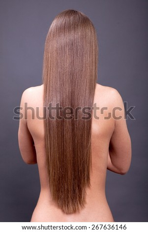 studio photography of young girl with healthy long hair
