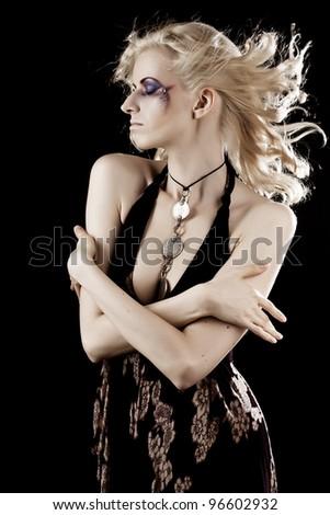Studio shot of a young, beautiful, blond, fashionable woman - stock photo