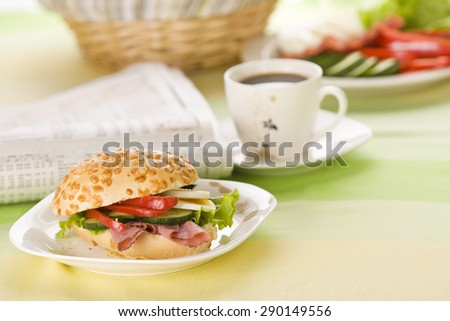 stuffed bun and a cup of coffee - stock photo
