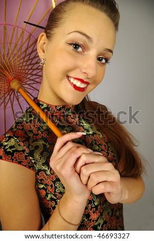 stylization of happy geisha with umbrella - stock photo