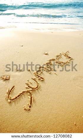 """Summer"" written in the sand beach , blue waves in the background - stock photo"