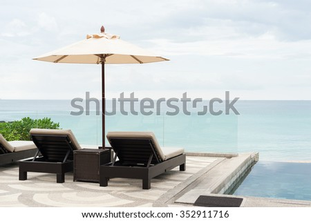 sunbed with  a beautiful beach - stock photo