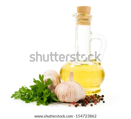 sunflower oil with parsley, garlic and spice isolated on white - stock photo