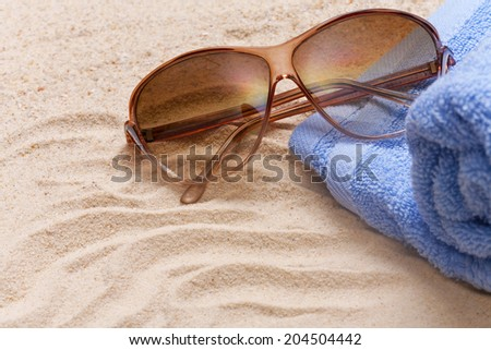 sunglasses on the beach - stock photo