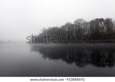 sunrise on the river during the late autumn, mist, cloudy, a small depth of field - stock photo
