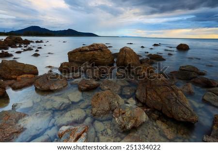 sunrise over beautiful rocky coastline  - stock photo