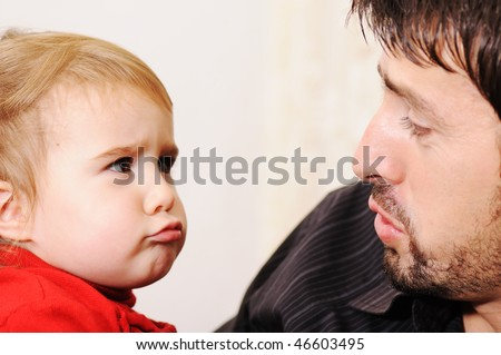 Super cute baby with father - stock photo