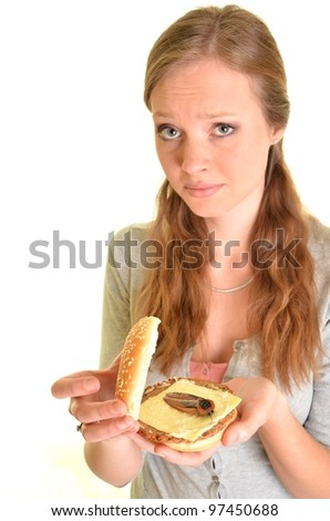 surprised woman with burger with cockroach - stock photo