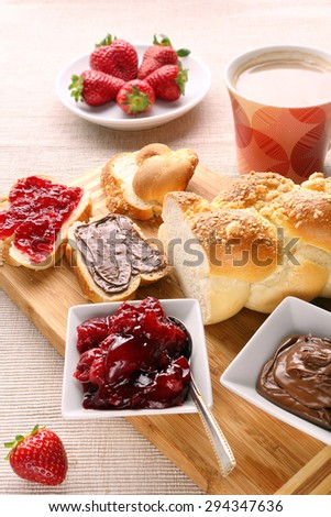 Sweet bread breakfast with strawberry jam and chocolate - stock photo