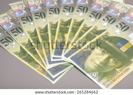 50 Swiss Franc bills isolated on gray background