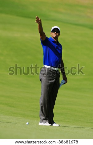 SYDNEY - NOV 13: American golfer Tiger Woods tests the breeze third round at the Emirates Australian Open at The Lakes golf course. Sydney - November 13, 2011 - stock photo