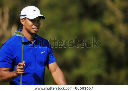 SYDNEY - NOV 12: American Tiger Woods in the third round in the Australian Open at The Lakes golf course. Sydney - November 12, 2011 - stock photo