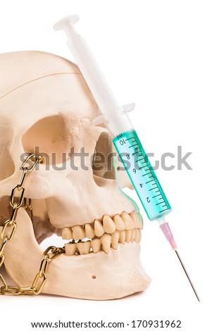 syringe and human skull  isolated on white  - stock photo