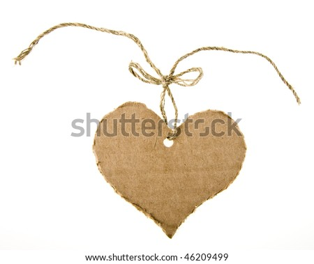 tag cardboard in the form of hearts with flax cord isolated on white background - stock photo