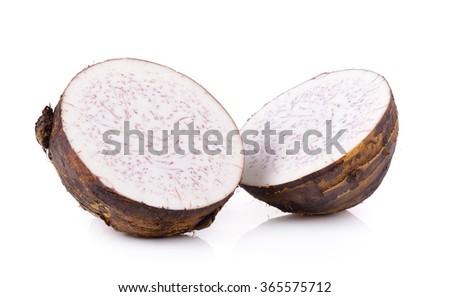 taro roots on white background - stock photo