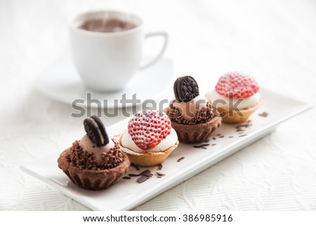4 tartlets and a cup of coffee - stock photo