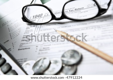 1040 Tax form in blank state, with other accessories.