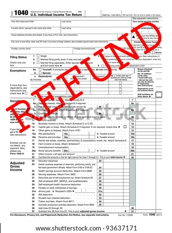 1040 Tax Form with caption Refund - stock photo
