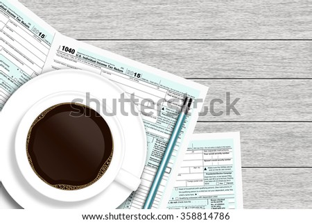 1040 tax form with coffee lying on wooden desk with place for text