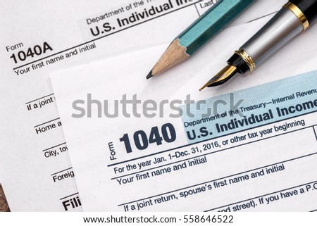 2017 tax form 1040 with pen.
