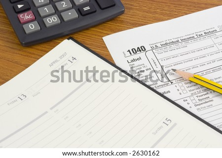 1040 tax form with pencil, calculator and calendar