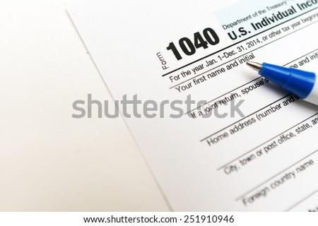 1040 tax return form isolated on white background - stock photo