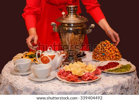 tea party. On a table covered with a white tablecloth, Russian samovar, tea, chak chak
