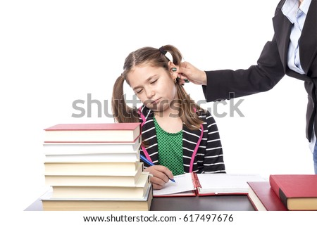 Teacher pulling her student ear over white background