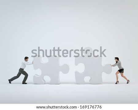 Teamwork, woman and man pushing toward each other puzzle - stock photo