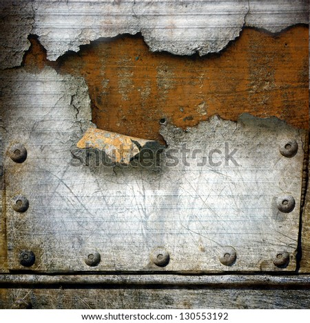 teared rusty metal plating; grunge abstract background - stock photo