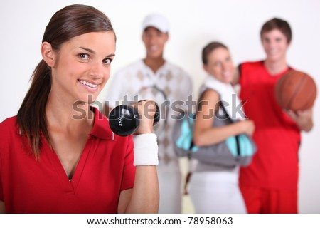 4 teenagers practicing different sports - stock photo