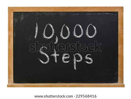 10,000 Ten thousand steps written in white chalk on a black chalkboard isolated on white - stock photo