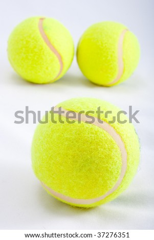 3 tennis ball on white